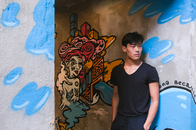 Sean Shih with Used Pencil's mural