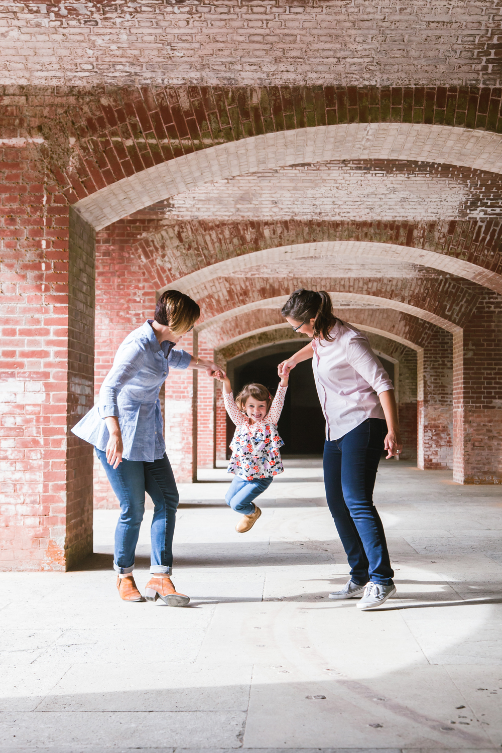 Swinging family portrait • Fort Point, San Francisco