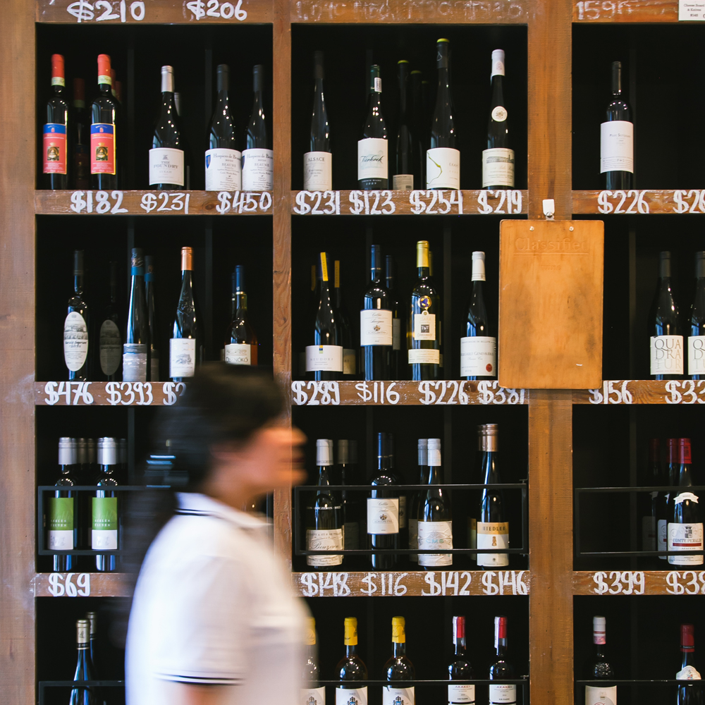 Movement at the wine shelves // Lifestyle Photographer in Hong Kong