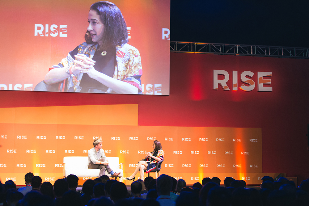 Melissa Guzy chatting with John Collison at RISE Conference | Event Photography Hong Kong