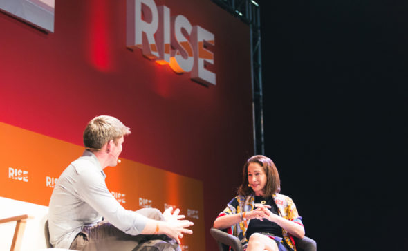 Melissa Guzy chatting with John Collison at RISE Conference