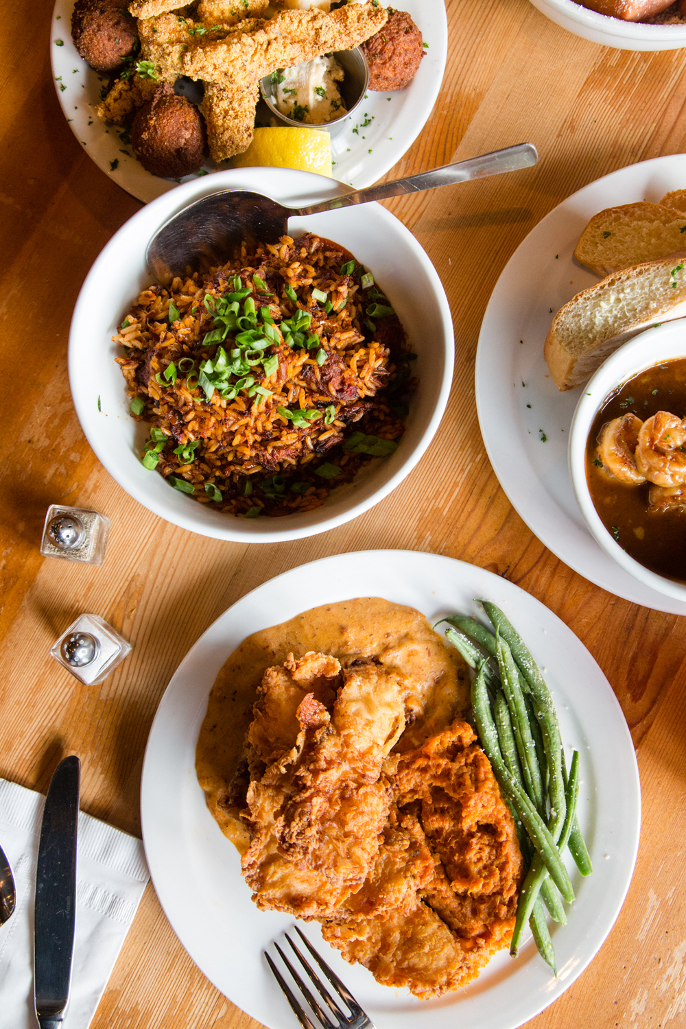 Dinner spread at Angeline's Louisiana Kitchen – Jambalaya, Hush Puppies, Fried Chicken ...
