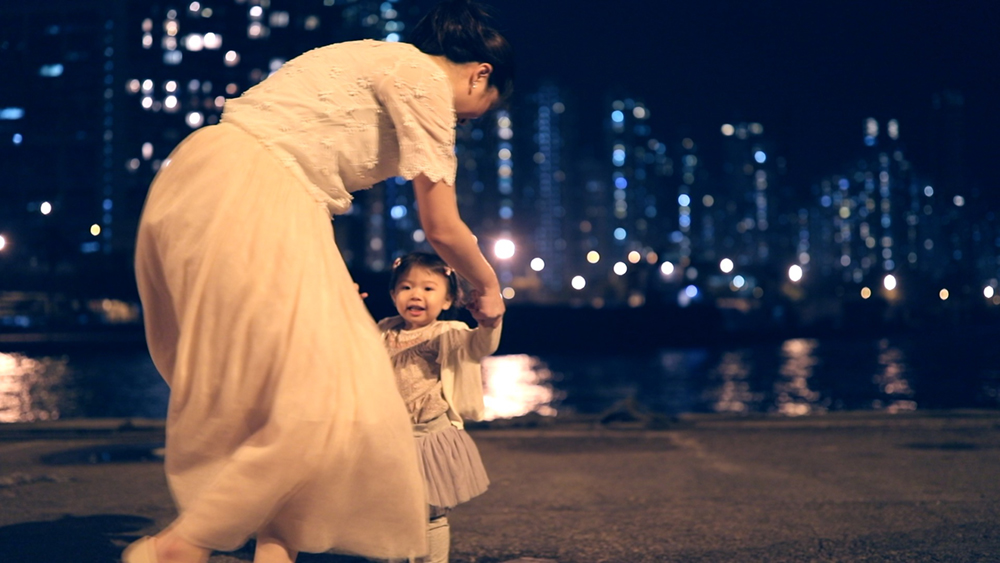 Mother and toddler at night | Instagram Pier | video campaign for Hong Kong Tourism Board | by Tracy Wong